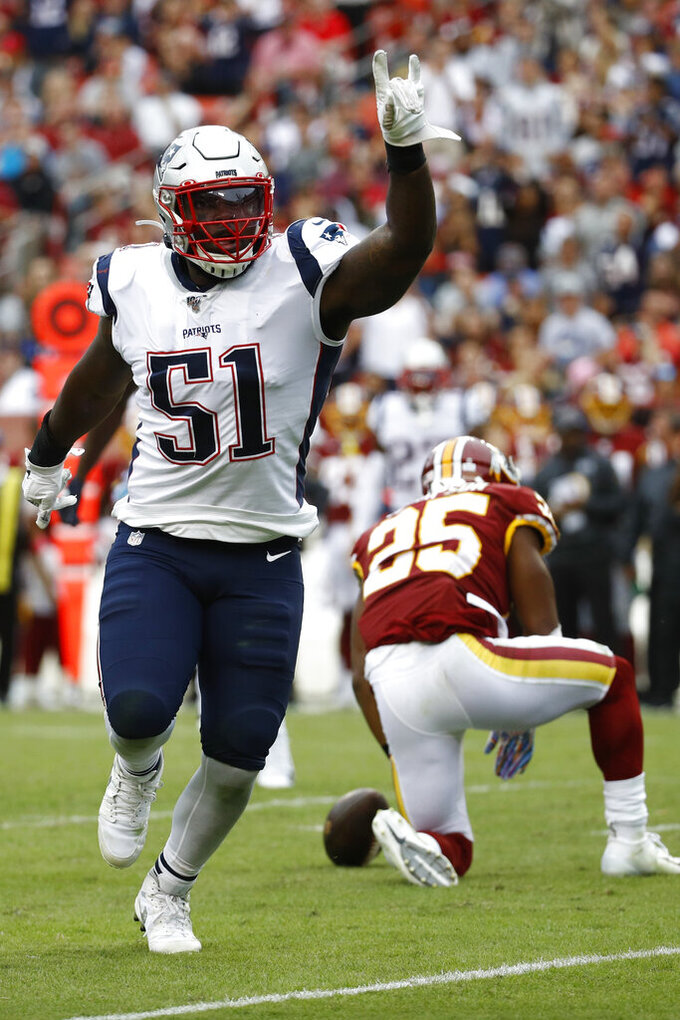 New England Patriots linebacker Ja'Whaun Bentley (51) celebrates a tackle against Washington Redskins running back Chris Thompson (25) during the second half of an NFL football game, Sunday, Oct. 6, 2019, in Washington. (AP Photo/Patrick Semansky)