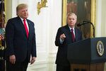 President Donald Trump listens to Sen. Lindsey Graham, R-S.C., speak during a ceremony in the East Room of the White House where Trump spoke about his judicial appointments, Wednesday, Nov. 6, 2019, in Washington. (AP Photo/Manuel Balce Ceneta)