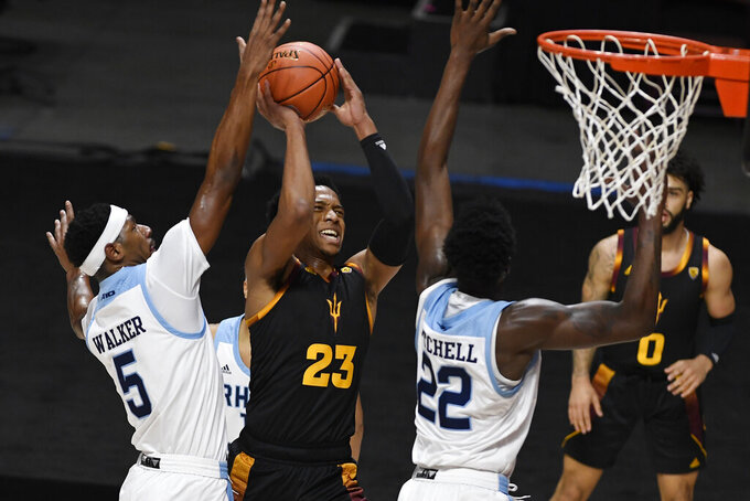 Arizona State's Marcus Bagley, center, goes up for a shot as Rhode Island's Antwan Walker, left, and Makhel Mitchell defend during the first half of an NCAA college basketball game Wednesday, Nov. 25, 2020, in Uncasville, Conn. (AP Photo/Jessica Hill)