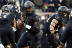 FILE - In this Dec. 8, 2018, file photo, Army quarterback Kelvin Hopkins Jr. drops back during the first half of an NCAA college football game against Navy in Philadelphia. The 120th Army-Navy game is set for Saturday in Philadelphia.  Army is trying to win its fourth straight game in the series.  (AP Photo/Matt Slocum, File)
