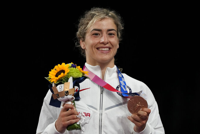 Bronze medalist United States' Helen Louise Maroulis celebrates on the podium for the women's women's 57kg Freestyle wrestling event,at the 2020 Summer Olympics, Thursday, Aug. 5, 2021, in Tokyo, Japan. (AP Photo/Aaron Favila)