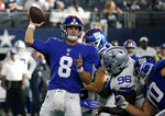New York Giants quarterback Daniel Jones (8) throws a pass under pressure from Dallas Cowboys defensive tackle Maliek Collins (96) in the second half of a NFL football game in Arlington, Texas, Sunday, Sept. 8, 2019. (AP Photo/Michael Ainsworth)