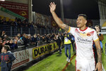 Catalans Dragons Israel Folau waves to the crowd after the Super League rugby match between Catalans Dragons and Castleford Tigers at Stade Gilbert Brutus in Perpignan, France, Saturday, Feb. 15, 2020. (AP Photo/Joan Monfort)