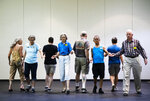 "This July 3, 2019 photo shows people participating during the annual International Association of Gay Square Dance Clubs convention in Philadelphia. The annual convention brought in 850 dancers bringing their best promenades and do-si-dos to a slightly sped-up version of ""Somewhere Over the Rainbow."" (AP Photo/Matt Rourke)"