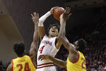 Indiana's Trayce Jackson-Davis (4) shoots over Maryland's Donta Scott (24) and Jalen Smith (25) during the first half of an NCAA college basketball game, Sunday, Jan. 26, 2020, in Bloomington, Ind. (AP Photo/Darron Cummings)