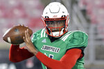 "FILE - In this March 7, 2019, file photo, Louisville quarterback Jawon Pass (4) participates in an NCAA college football scrimmage in Louisville, Ky. Jawon ""Puma"" Pass will likely begin his second consecutive season as the starter despite a rollercoaster debut. (AP Photo/Timothy D. Easley, File)"