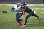 Tennessee Titans cornerback Malcolm Butler, left, breaks up a pass intended for Jacksonville Jaguars wide receiver DJ Chark Jr. (17) during the second half of an NFL football game, Sunday, Dec. 13, 2020, in Jacksonville, Fla. (AP Photo/Stephen B. Morton)