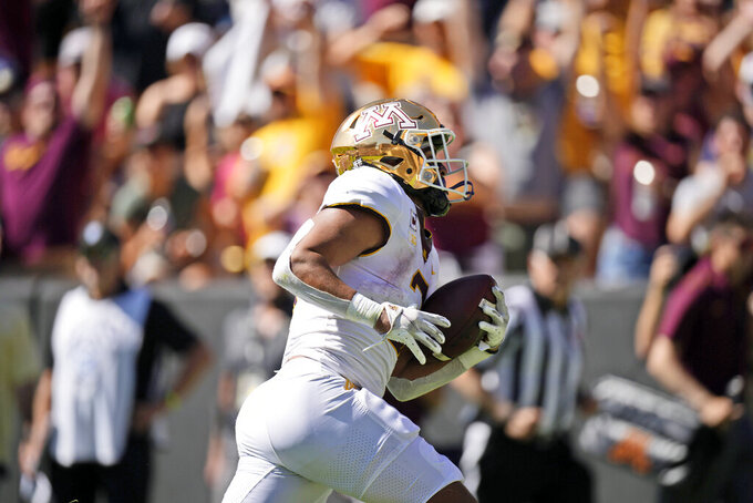 Minnesota running back Treyson Potts runs for a touchdown in the first half of an NCAA college football game against Colorado, Saturday, Sept. 18, 2021, in Boulder, Colo. (AP Photo/David Zalubowski)