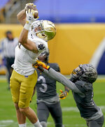Notre Dame wide receiver Ben Skowronek (11) makes a catch over Pittsburgh defensive back Marquis Williams (14) and takes it in for a touchdown during the first half of an NCAA college football game, Saturday, Oct. 24, 2020, in Pittsburgh. (AP Photo/Keith Srakocic)