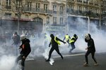 Teargas is used to disperse demonstratos during minor clashes with police in Paris, Saturday, March 23, 2019. The French government vowed to strengthen security as yellow vest protesters stage a 19th round of demonstrations, in an effort to avoid a repeat of last week's riots in Paris. (AP Photo/Kamil Zihnioglu)