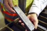 In this Wednesday, May 29, 2019 photo, core samples show the mineral deposits sought after by miners at the site of the Polymet copper-nickel mine in Hoyt Lakes, Minn. The developers of the proposed mine in northern Minnesota are courting bankers for nearly $1 billion to move ahead with the project, even as opponents hold out hope of blocking the operation due to fears of water pollution.  (Anthony Souffle/Star Tribune via AP)