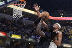Los Angeles Clippers' Montrezl Harrell (5) puts up a shot against Indiana Pacers' Myles Turner (33) during the first half of an NBA basketball game, Monday, Dec. 9, 2019, in Indianapolis. (AP Photo/Darron Cummings)