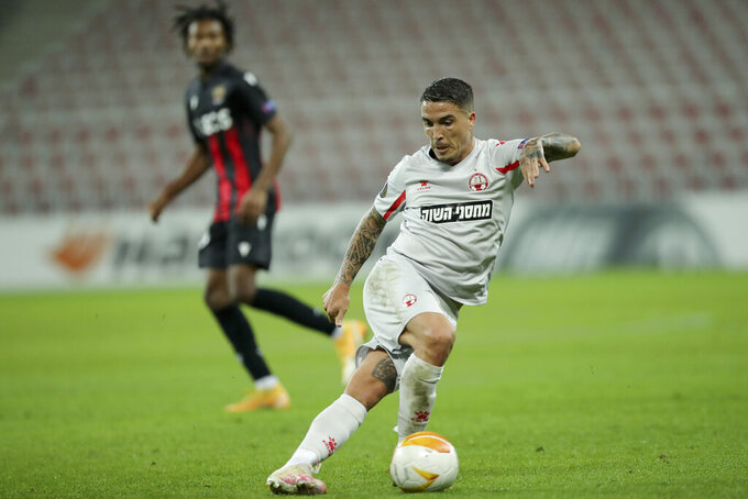 Hapoel Beer-Sheva's Josue controls the ball during the Europa League Group C soccer match between OGC Nice and Hapoel Beer-Sheva at the Allianz Riviera stadium in Nice, France,Thursday, Oct. 29, 2020. (AP Photo/Daniel Cole)