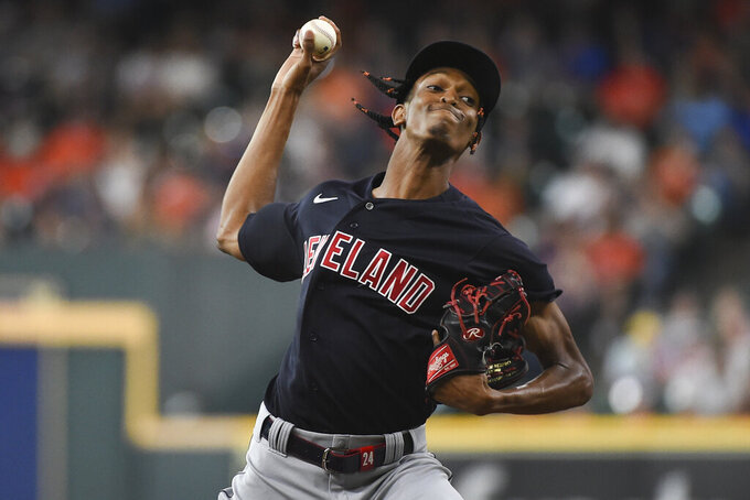 Cleveland Indians starting pitcher Triston McKenzie delivers during the first inning of the team's baseball game against the Houston Astros, Tuesday, July 20, 2021, in Houston. (AP Photo/Eric Christian Smith)