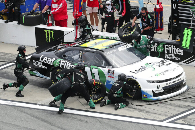 Justin Haley (11) gets tire and fuel during a pit stop in the NASCAR Xfinity Series auto race at Daytona International Speedway, Saturday, Aug. 28, 2021, in Daytona Beach, Fla. (AP Photo/David Graham)