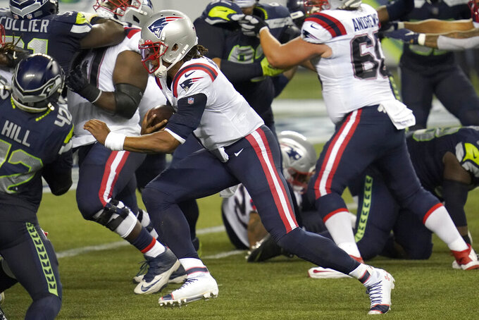 New England Patriots quarterback Cam Newton rushes for a touchdown against the Seattle Seahawks during the second half of an NFL football game, Sunday, Sept. 20, 2020, in Seattle. (AP Photo/Elaine Thompson)