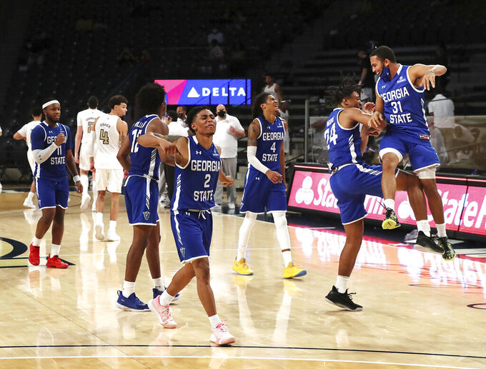 Georgia State players celebrate after defeating Georgia Tech 123-120 in four overtimes in an NCAA college basketball game, early Thursday, Nov. 26, 2020, in Atlanta. (Curtis Compton/Atlanta Journal-Constitution via AP)