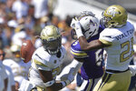 Alcorn State wide receiver Charles Hughes (5) fumbles the ball after hit by Georgia Tech defensive backs Tariq Carpenter (29) and  Zamari Walton (21) in the second half of an NCAA college football game Saturday, Sept. 1, 2018, in Atlanta. (Hyosub Shin/Atlanta Journal-Constitution via AP)