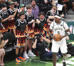 Milwaukee Bucks fans cheer for forward Bobby Portis after he scored against the Atlanta Hawks during the third quarter in Game 5 of the Eastern Conference finals in the NBA basketball playoffs Thursday, July 1, 2021, in Milwaukee. (Curtis Compton/Atlanta Journal-Constitution via AP)