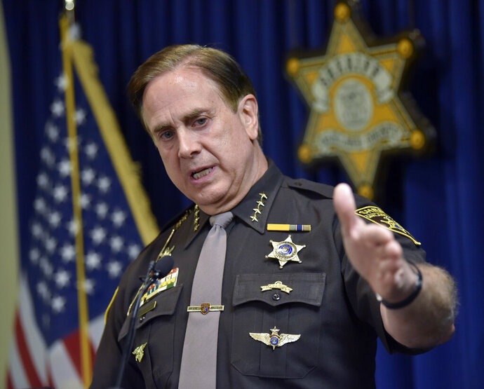 Oakland County Sheriff Michael Bouchard speaks at a news conference, Thursday, July 2, 2020, in Pontiac, Mich., to confirm one felonious assault charge each has been filed against Eric and Jillian Wuestenberg, both of Independence Township, after a confrontation that resulted in pointing hand guns at Takelia Hill and her children after exiting a restaurant in Orion Township, a day earlier. (Todd McInturf/Detroit News via AP)