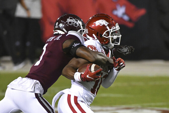 Mississippi State cornerback Martin Emerson (1) tackles Arkansas wide receiver De'Vion Warren (10) after a catch during the first half of an NCAA college football game in Starkville, Miss., Saturday, Oct. 3, 2020. (AP Photo/Thomas Graning)