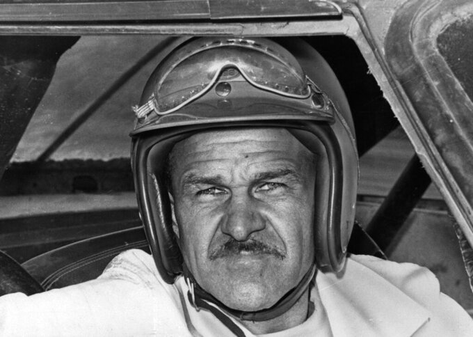 FILE - In this Aug. 1, 1969, file photo, Wendell Scott sits in a race car, location not known. NASCAR will celebrate the legacy of NASCAR Hall of Fame driver Wendell Scott and present the Scott family a trophy commemorating the driver's historic race victory at Speedway Park in Jacksonville, Fla. in 1963. A native of Danville, Va., Scott was the first African-American driver in NASCAR to win a race in the sport's top series. (AP Photo/File)