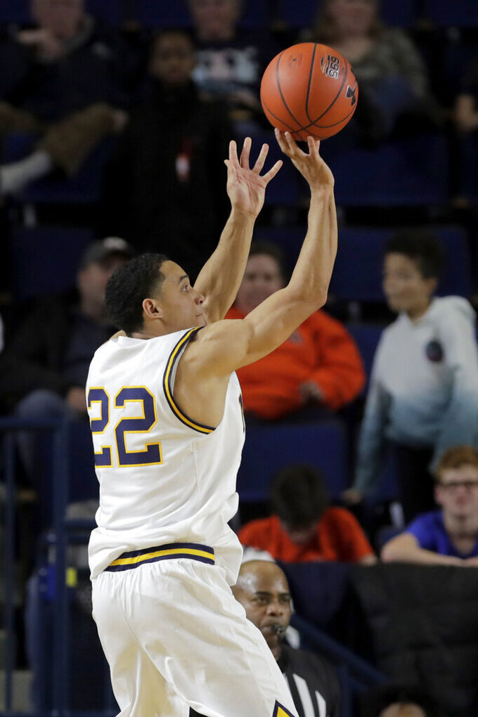 Navy guard Cam Davis shoots against East Carolina during the first half of an NCAA college basketball game at the Veterans Classic Tournament, Friday, Nov. 8, 2019, in Annapolis, Md. (AP Photo/Julio Cortez)
