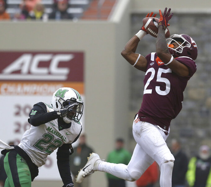 Tre Turner (25) of Virginia Tech catches a 45 yard touchdown pass from quarterback Ryan Willis past Jestin Morrow (22) of Marshall in the second quarter  of an NCAA college football game in Blacksburg Va. Saturday, Dec. 1 2018. (Matt Gentry/The Roanoke Times via AP)
