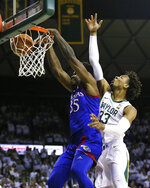 Kansas center Udoka Azubuike, left, dunks the ball as Baylor forward Freddie Gillespie, right defends during the first half of an NCAA college basketball game on Saturday, Feb. 22, 2020, in Waco, Texas. (AP Photo/Ray Carlin)