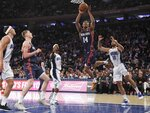 New York Knicks' Allonzo Trier (14) drives past Orlando Magic's Evan Fournier (10) during the second half of an NBA basketball game Tuesday, Feb. 26, 2019, in New York. The Knicks won 108-103. (AP Photo/Frank Franklin II)