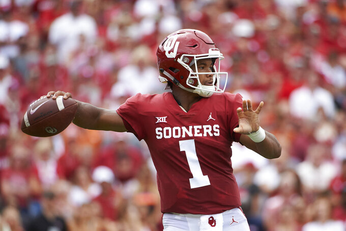 Oklahoma quarterback Kyler Murray (1) throws a pass against Texas during the first half of an NCAA college football game at the Cotton Bowl, Saturday, Oct. 6, 2018, in Dallas. (AP Photo/Cooper Neill)