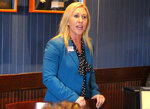 FILE - In this March 3, 2020, file photo, Republican Marjorie Taylor Greene speaks to a GOP women's group in Rome, Ga. Greene, criticized for promoting racist videos and adamantly supporting the far-right QAnon conspiracy theory, has won the GOP nomination for northwest Georgia's 14th Congressional District. (John Bailey/Rome News-Tribune via AP, File)