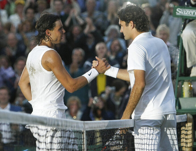 FILE - In this Sunday, July 6, 2008 file photo Spain's Rafael Nadal left, shakes the hand of Switzerland's Roger Federer after winning the men's final on the Centre Court at Wimbledon. After going more than 1½ years without playing each other anywhere, Roger Federer and Rafael Nadal will be meeting at a second consecutive Grand Slam tournament when they face off in Wimbledon's semifinals. (AP Photo/Anja Niedringhaus, File)