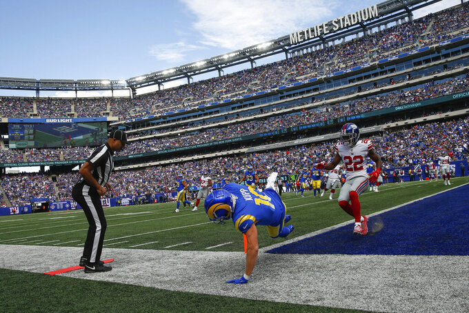 Los Angeles Rams' Cooper Kupp, center, scores a touchdown as New York Giants' Adoree' Jackson, right, looks on during the first half of an NFL football game, Sunday, Oct. 17, 2021, in East Rutherford, N.J. (AP Photo/John Munson)