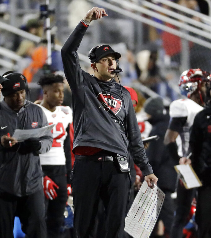 Western Kentucky head coach Mike Sanford directs his players in the first half of an NCAA college football game against Middle Tennessee, Friday, Nov. 2, 2018, in Murfreesboro, Tenn. (AP Photo/Mark Humphrey)