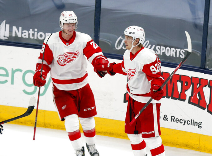 Detroit Red Wings' Vladislav Namestnikov, right, celebrates his goal with Gustav Lindstrom during the third period of the team's NHL hockey game against the Columbus Blue Jackets in Columbus, Ohio, Friday, May 7, 2021. The Red Wings won 5-2. (AP Photo/Paul Vernon)