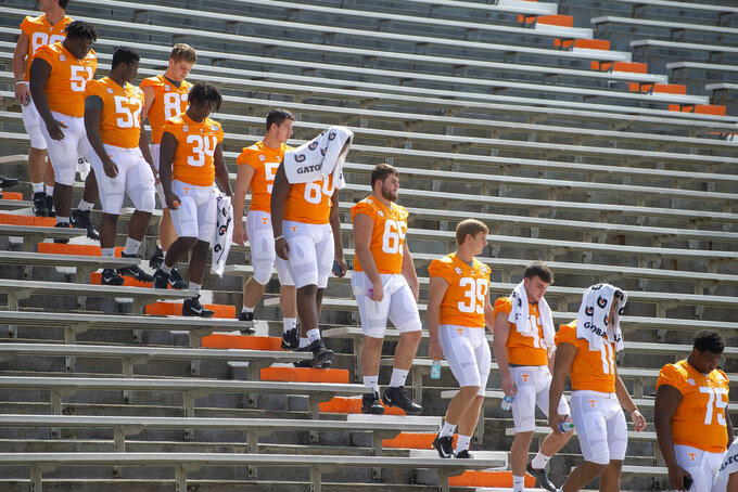 Tennessee NCAA college football players gather for a team photo shoot in Knoxville, Tenn., Sunday, Aug. 4, 2019. (Saul Young/Knoxville News Sentinel via AP)