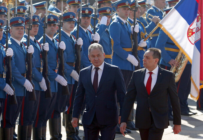Russian Defense Minister Sergei Shoigu, left, reviews the honour guard with his Serbian counterpart Aleksandar Vulin during a welcome ceremony in Belgrade, Serbia, Monday, Feb. 17, 2020. Shoigu is on a one-day official visit to Serbia. (AP Photo/Darko Vojinovic)