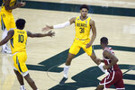 Baylor guard Adam Flagler, left, and Baylor guard MaCio Teague, right, slap hands after a basket against the Oklahoma during the second half of an NCAA college basketball game on Wednesday, Jan. 6, 2021, in Waco, Texas. (AP Photo/Ray Carlin)