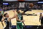 Boston Celtics forward Jayson Tatum, center, goes to the basket against Sacramento Kings guard Bogdan Bogdanovic, left, during the second half of an NBA basketball game Wednesday, March 6, 2019, in Sacramento, Calif. The Celtics won 111-109. (AP Photo/Rich Pedroncelli)