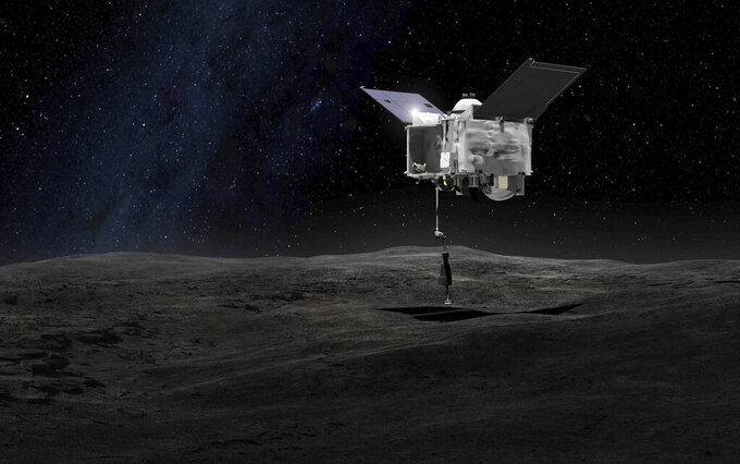FILE - This artist's rendering made available by NASA on Tuesday, Sept. 6, 2016 shows the Origins Spectral Interpretation Resource Identification Security - Regolith Explorer (OSIRIS-REx) spacecraft contacting the asteroid Bennu with the Touch-And-Go Sample Arm Mechanism. (NASA/Goddard Space Flight Center via AP)