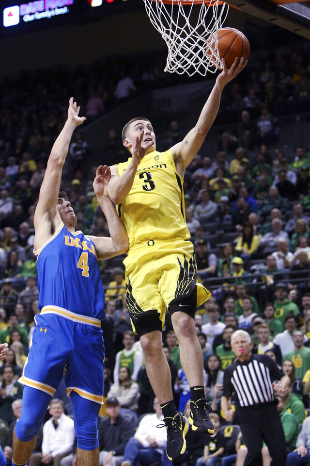 Oregon's Payton Pritchard, right, shoots past UCLA's Jaime Jaquez Jr., left, during the first half of an NCAA basketball game in Eugene, Ore., Sunday, Jan. 26, 2020. (AP Photo/Chris Pietsch)