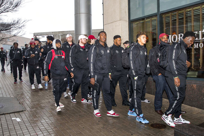 The Oklahoma Sooners football team arrived at the Omni Hotel in Atlanta, Monday, Dec. 23, 2019. The Oklahoma Sooners will face the LSU Tigers in the Chick-fil-a A Peach Bowl at Mercedes-Benz Stadium Saturday, December 28. (Alyssa Pointer/Atlanta Journal-Constitution via AP)