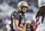 James Madison wide receiver Riley Stapleton (10) celebrates after scoring a touchdown during the first half of an NCAA college football game against Richmond in Harrisonburg, Va, Saturday, Nov. 16, 2019. (Daniel Lin/Daily News-Record via AP)