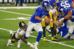 New York Giants quarterback Daniel Jones (8) is sacked by Pittsburgh Steelers cornerback Mike Hilton (28) during the fourth quarter of an NFL football game Monday, Sept. 14, 2020, in East Rutherford, N.J. (AP Photo/Seth Wenig)