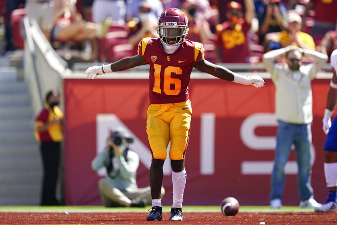 Southern California wide receiver Tahj Washington (16) celebrates after catching a pass in the end zone for a touchdown during the first half of an NCAA college football game against San Jose State Saturday, Sept. 4, 2021, in Los Angeles. (AP Photo/Ashley Landis)