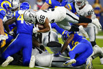 Las Vegas Raiders running back Trey Ragas lunges into the end zone for a rushing touchdown during the first half of the team's preseason NFL football game against the Los Angeles Rams on Saturday, Aug. 21, 2021, in Inglewood, Calif. (AP Photo/Jae C. Hong)