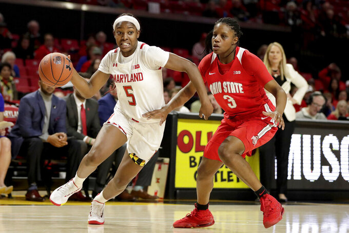 Maryland guard Kaila Charles (5) drives against Ohio State guard Janai Crooms (3) during the second half of an NCAA college basketball game, Monday, Jan. 6, 2020, in College Park, Md. Maryland won 72-62. (AP Photo/Julio Cortez)