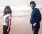 This photo provided by Tara Reade, shows Tara Reade and her half-brother Michael Enterline on the beach in Morro Bay, Calif., in 1989. (Tara Reade via AP)