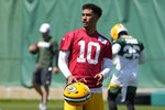Green Bay Packers' Jordan Love runs a drill during an NFL football minicamp Tuesday, June 8, 2021, in Green Bay, Wis. Aaron Rodgers' absence from the Green Bay Packers' minicamp means more opportunities for 2020 first-round draft pick Jordan Love, who now must prepare for the possibility he could open the season as a starting quarterback after not playing a single down his rookie year. (AP Photo/Morry Gash)